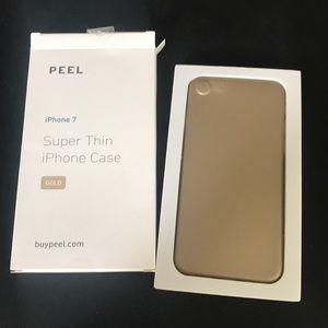 Gold PEEL case for iPhone 7. New, in open box.